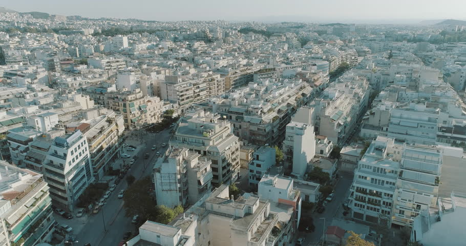 4K Athens aerial downtown buildings rooftops.Aerial views of tight concrete buildings and vertical views of, typical downtown neighbourhoods streets and rooftops near the center of Athens. | Shutterstock HD Video #1010408171
