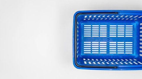 Shopping cart in a supermarket. Grocery store. Food basket. Fruits, vegetables, milk, wine, eggs. Stop Motion. 4k