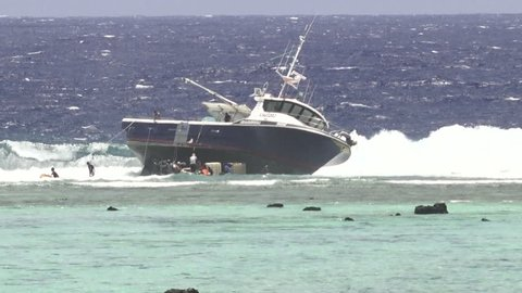 RAROTONGA - JAN 08 2018:Grounding of a domestic longline fishing boat FV Zambucca on a reef in Rarotonga Cook Islands Could pose an environmental threat to the area.