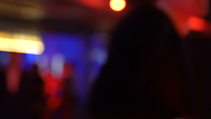 Young man and woman kissing in bar, one-night relations, clubbing lifestyle | Shutterstock HD Video #1010427191
