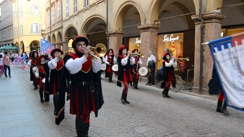 Modena, Italy - 04 22 2018: Footage of medieval costumes parade with musician and flag throwers.