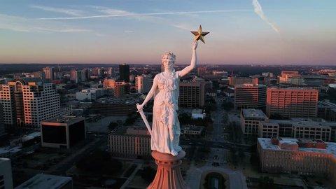 4K Aerial Texas Capitol Austin Orbiting at Sunset - Goddess of Liberty