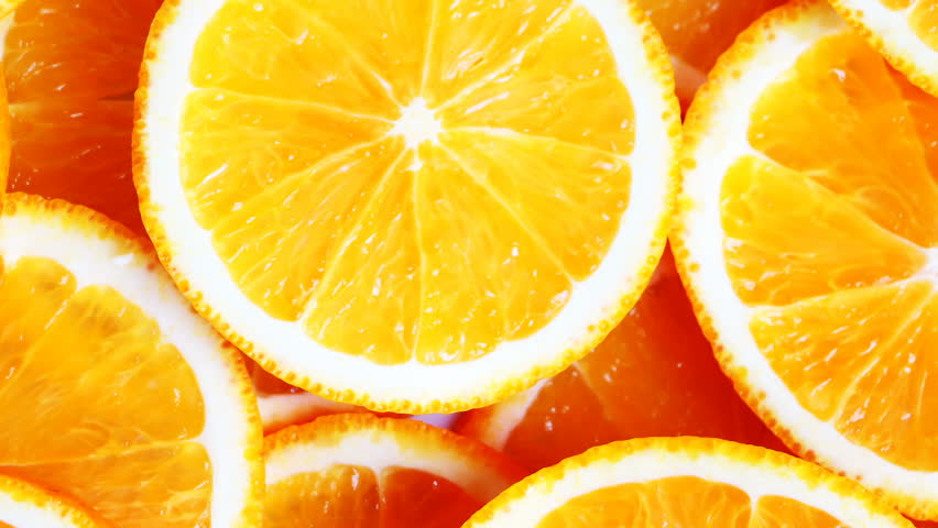 Orange cuts. Slow pan of fresh bright oranges (orange fruits) slices. Closeup.	 | Shutterstock HD Video #1010472791
