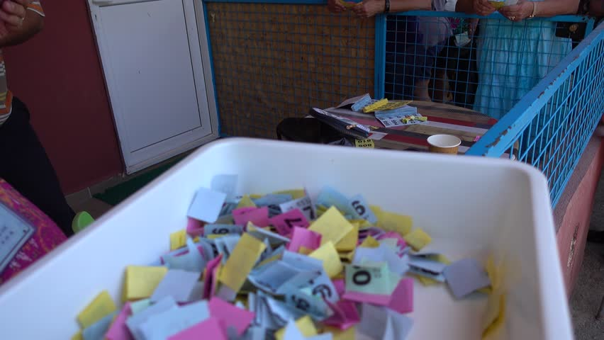 4K Raffle game in progress and a box full of raffle numbers