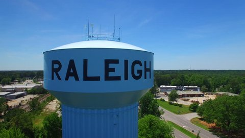 Slow aerial reveal of a water tower in Raleigh North Carolina