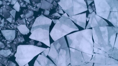 Aerial view of cracked ice floes. Global warming, climate change winter background