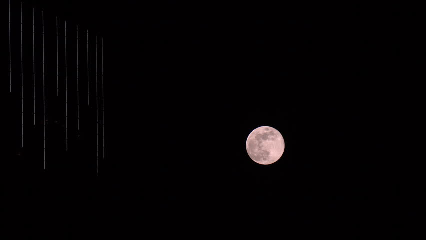 Full Moon In April Is Called Pink But For Reasons Unknown To The Videographer This Rising Does Ear With Illuminated Modern High Rise
