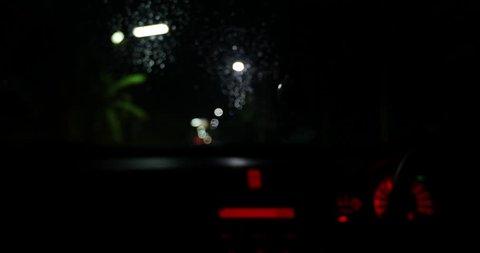 Defocused night traffic lights in car - Bangkok street - abstract background