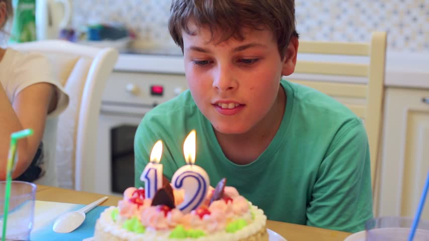 Sensational Boy Sits At Table With Stock Footage Video 100 Royalty Free Funny Birthday Cards Online Unhofree Goldxyz