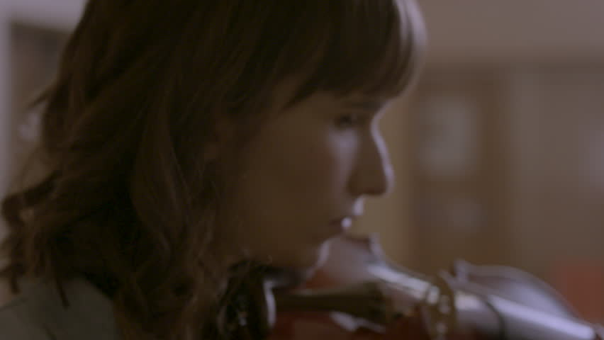 Close-up of musician playing her violin HD stock video. Alexa camera