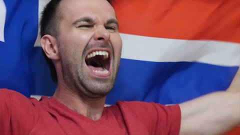 Norwegian Fan Celebrating while holding the Flag of Norway in Slow Motion