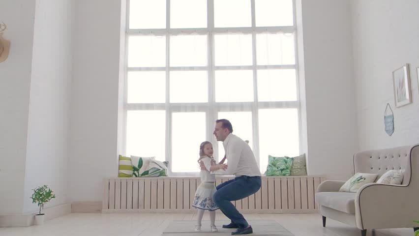 Happy Family Idyll Little Child Daughter Jump On Father Arms.