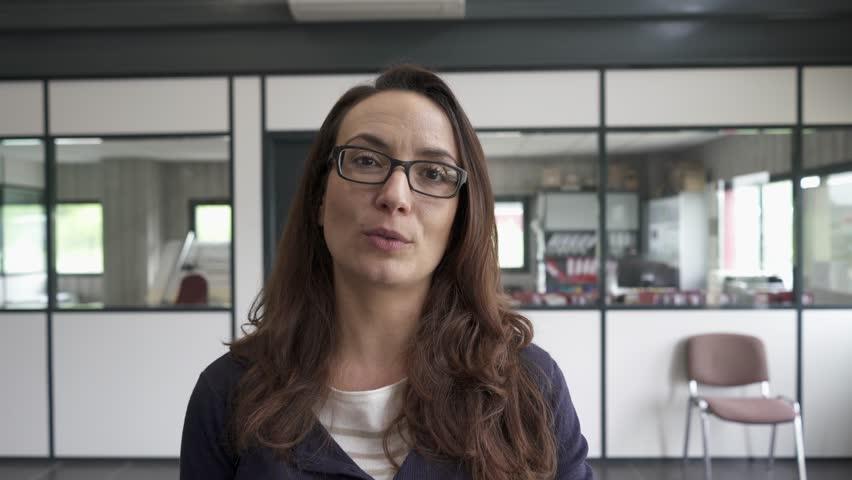 Businesswoman in office talking to camera | Shutterstock HD Video #1010694431