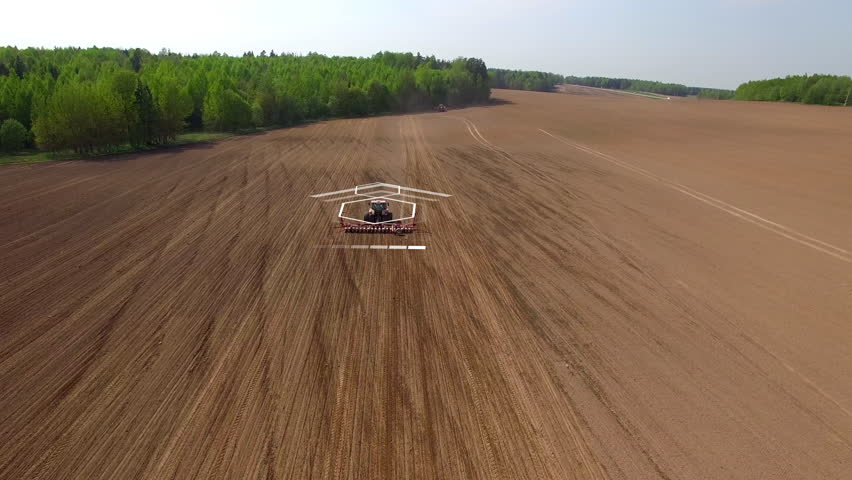 Tractor cultivating land with using an advanced autopilot and radar system, sensor and control of the surrounding space detectors. 4k