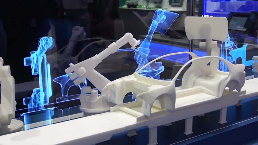 Hannover, Germany - April, 2018: Simulating of car manufacturing by robots, digital twin of the production on Siemens stand on Messe fair in Hannover, Germany