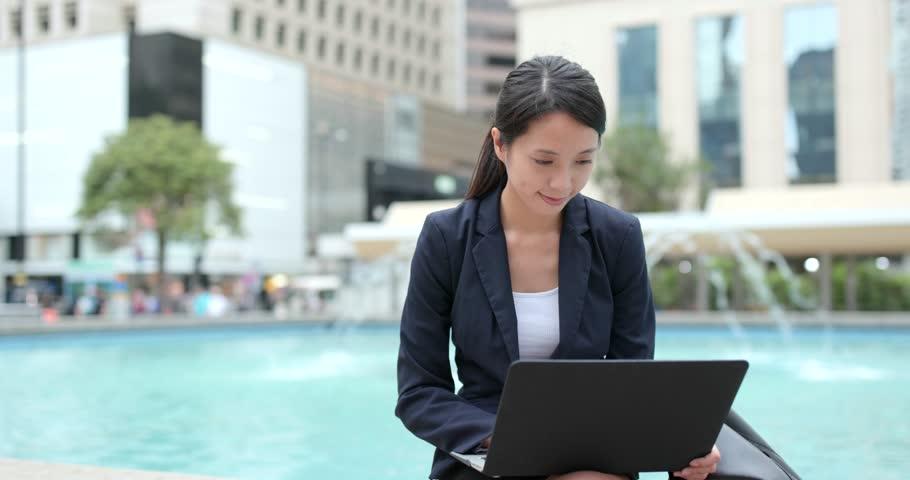 Asian business woman use of notebook computer in Hong Kong | Shutterstock HD Video #1010749661