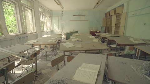 Classroom in an abandoned school in Pripyat. Chernobyl nuclear disaster. Slider shot - Juni 2017: 30km Chernobyl, exclusion zone