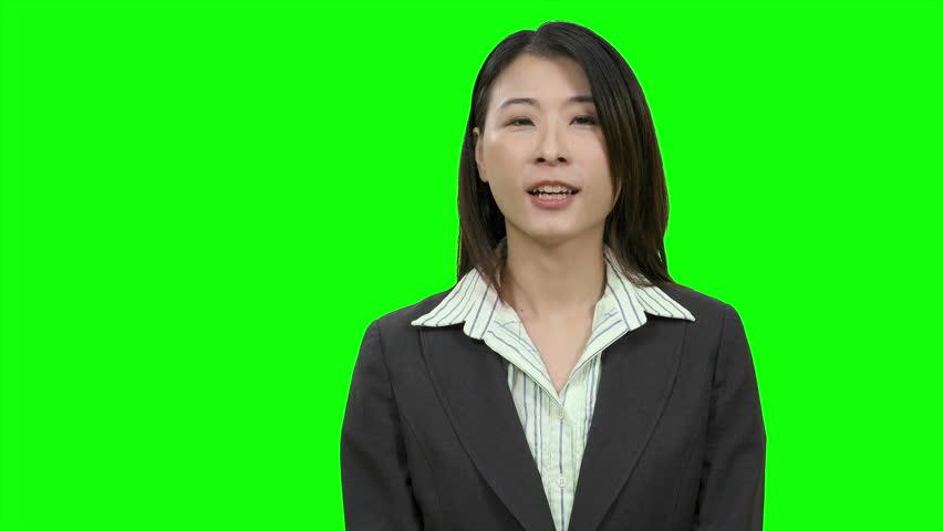 Asian woman presenting on Green Screen, TV media, anchor concept | Shutterstock HD Video #1010818301