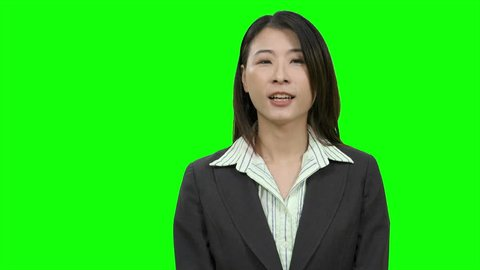 Asian woman presenting on Green Screen, TV media, anchor concept