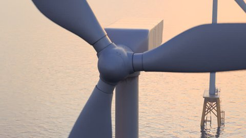 Offshore wind turbines at dusk. Close up camera.