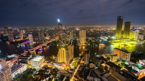 Bangkok, Thailand - January 1, 2018: Bangkok Timelapse view showing city skyline and view over lightshow and Chao Phraya river at night