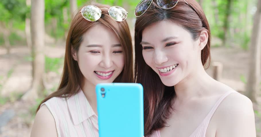 Two beauty women wear brace and retainer for teeth selfie happily   Shutterstock HD Video #1010899571