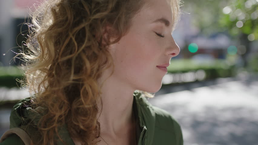 Slow motion portrait of beautiful young elegant woman redhead feeling relaxed peaceful enjoying wind blowing hair blissful relief | Shutterstock HD Video #1010918561