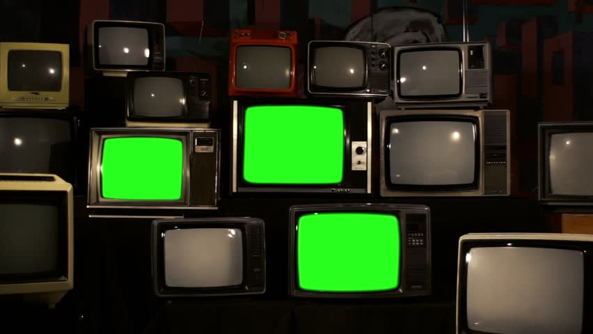 "80s Televisions with Green Screens that Turn On. Gold Tobacco Tone. Zoom In Fast. Ready to Replace Green Screens with any Footage or Picture you Want. You can do it with ""Keying"" (Chroma Key) Effect. 