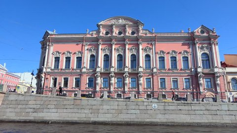 View from riverboat slowly passing through canals of St. Petersburg, nice architecture and beautiful sunny day