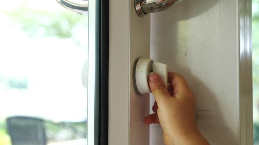 Hand baby trying open the door | Shutterstock HD Video #1011015551