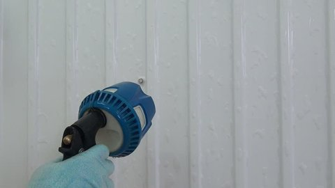 Cleaning and disinfection of walls in industrial food production from remnants of food. Application of disinfectant solution. Washing of premises and equipment in food industry, supermarkets.