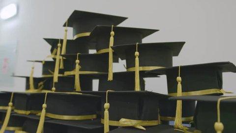 Celebrating academic achievement. Graduation day caps