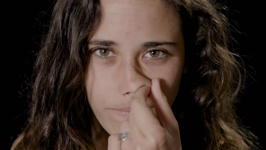 girl picking her nose
