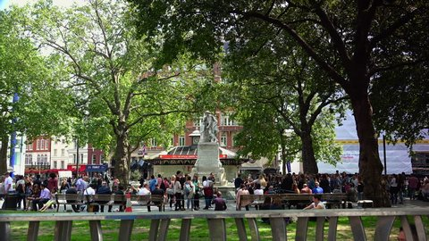 LONDON, UK - circa 2018: Centre London Cinema and Shopping Street in Leicester Square Theatreland in London People Walk Visit