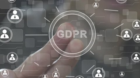 Businessman presses button GDPR general data protection regulation on virtual electronic user interface icon