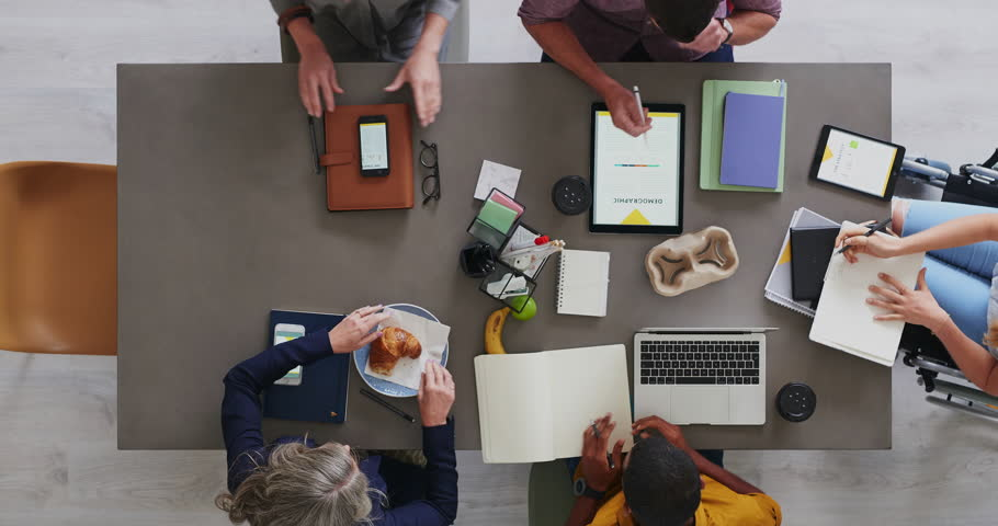 top view of multi ethnic business team brainstorming innovative ideas for startup company developing market strategy disabled employees in diverse group of people time lapse close up rotate #1011129941