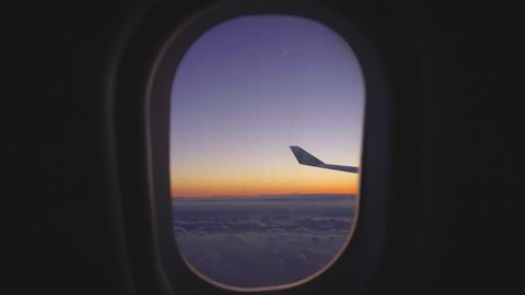 airplane window view at sunset sunrise. passenger aircraft aviation airline flying traveling