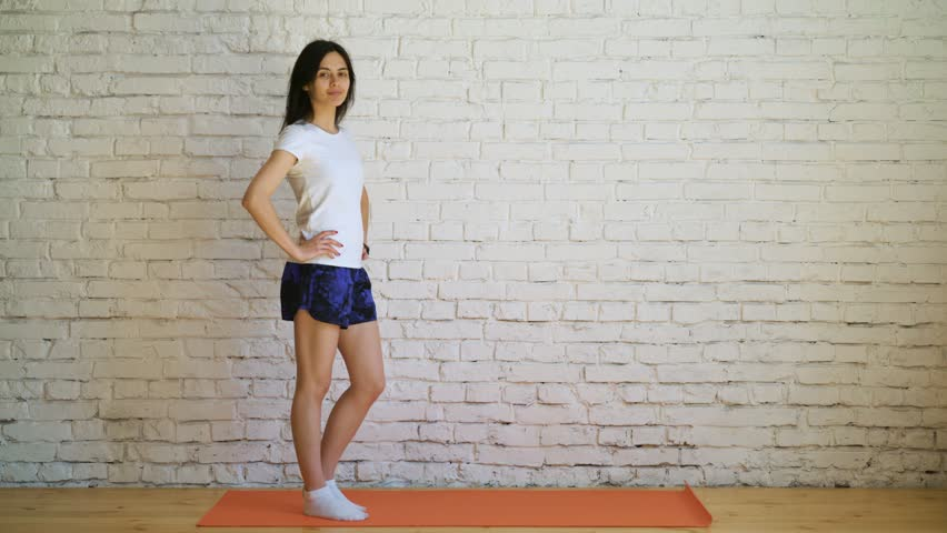 Beautiful young girl doing exercises at home | Shutterstock HD Video #1011157931
