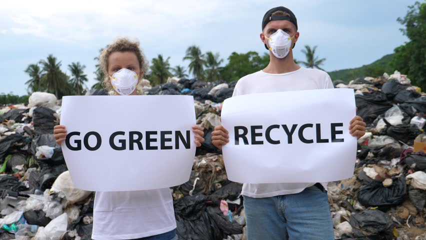 Pollution Environmental Contamination And Eco-Disaster - Activists Couple on Disposal Site.