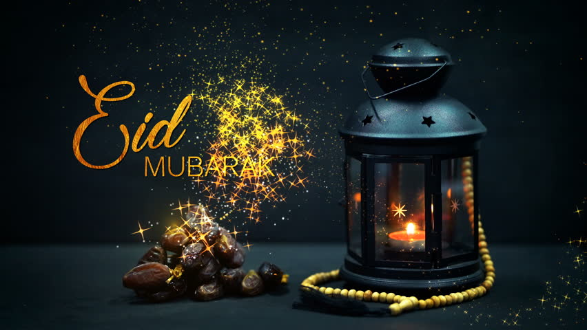 "Eid Mubarak Greeting Gold Glitter Particles. Ramadan Candle Lantern with Wooden Prayer Beads and Dates. ""Eid Mubarak"" means ""Blessed Festival"" 