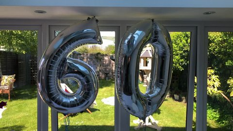 60th Birthday celebration part balloons silver metallic