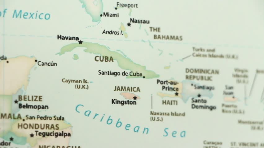 Cuba and Jamaica on a political map of the world. Video defocuses showing and hiding the map.