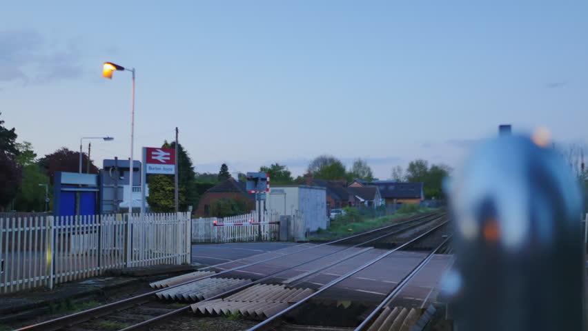 4K British train passing in the East Midlands. Railway station platform in England UK