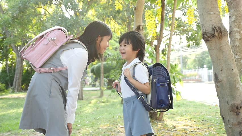 Cute Asian children going to the school outdoors slow motion   Shutterstock HD Video #1011314861
