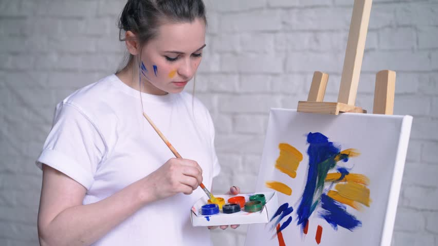Young Woman Artist In Apron Stock Footage Video 100 Royalty Free 1011320021 Shutterstock