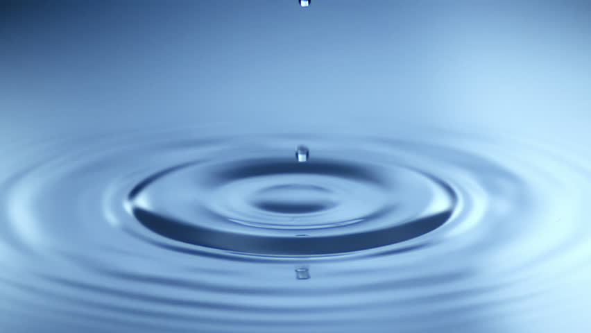 Slow Motion Water drop splash into calm water - shot with ultra high speed camera | Shutterstock HD Video #1011346571
