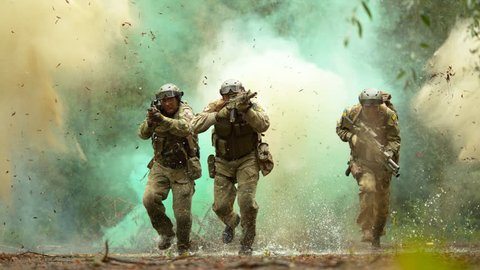 Military men in action on the battlefield, slow motion