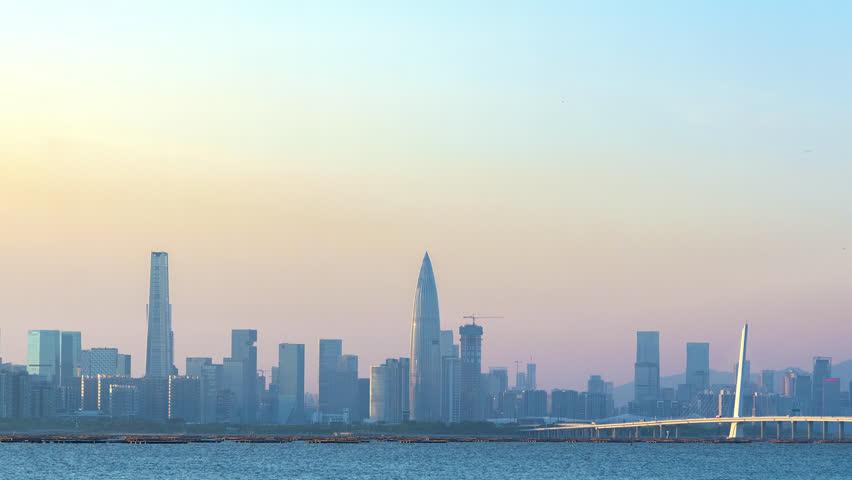 Skyline of Shekou district, Shenzhen city, China at dusk. Viewed from Hong Kong | Shutterstock HD Video #1011394031