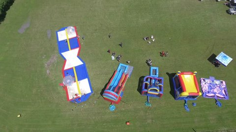aerial zorb ball and other water game at fairgrounds above view 4k