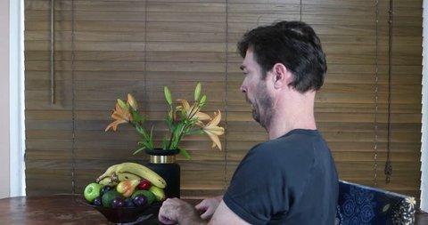 man pretending to eat weirdly